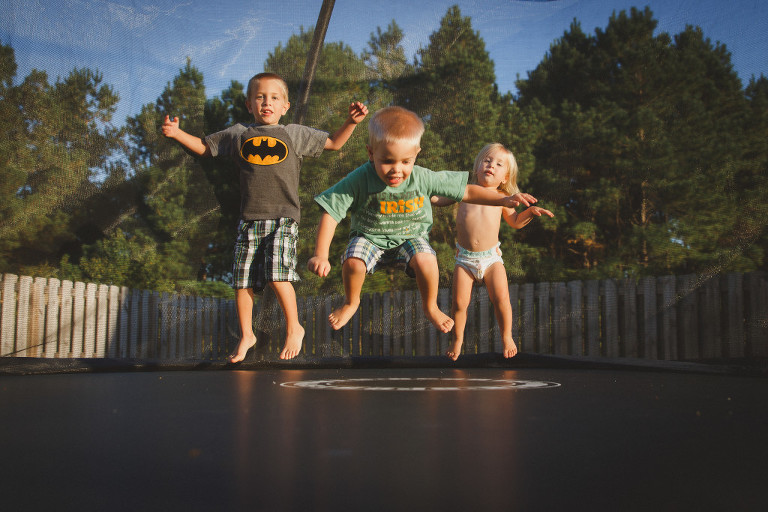 Hampstead backyard family photo session with trampoline
