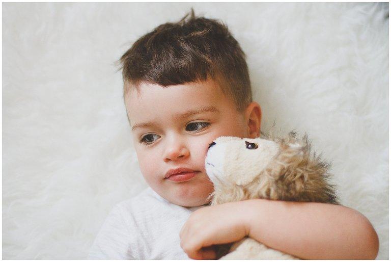 toddler holding stuffed animal