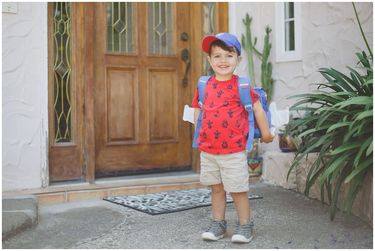 Toddler wearing backpack in his back-to-school photo